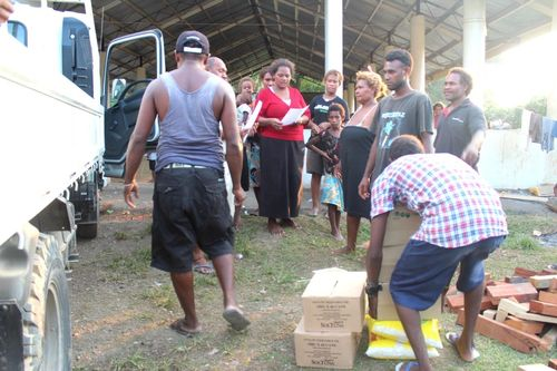 Distribution of relief supplies to one of the evacuation centres