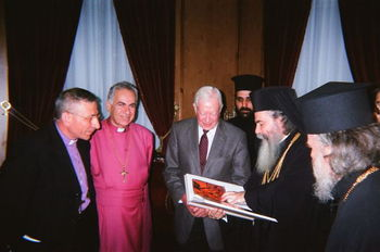 Pres_Carter_with_Bishop_Dawani__and_Lutheran_Bishop_Mounib_with_HB_Greek_Patriarch_presenting_a_Gift_Book_on_Jerusalem.jpg