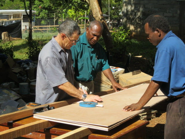 Peter Williamson designing and building shelves for the school library at Norman Palmer School.