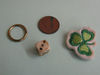 Metal ring, coin, dice, clover patch.