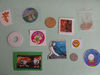 Rubber washer, coins, stickers, tazos, thread.